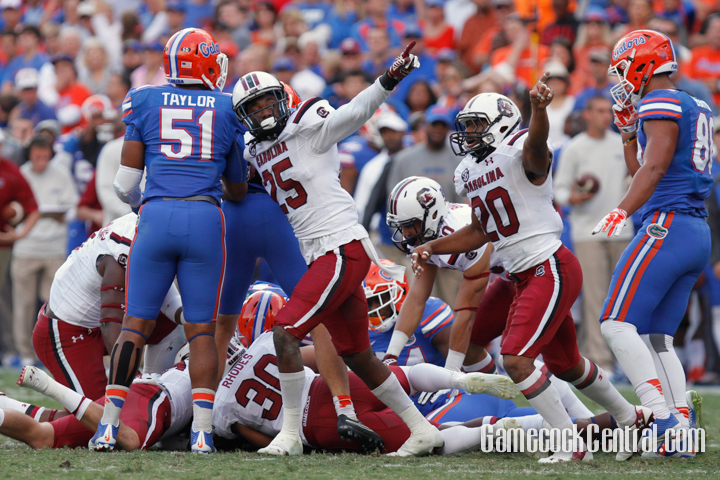 """Staff Photo by C.J. Driggers: Heard's blocked punt helped the Gamecocks stun the Gators in """"The Swamp."""""""
