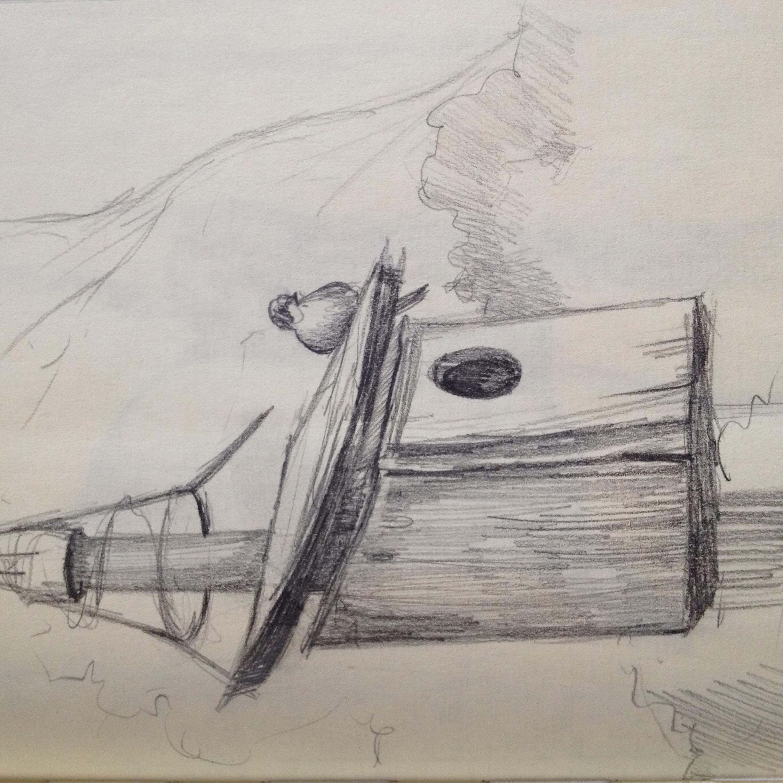A bird on a birdhouse