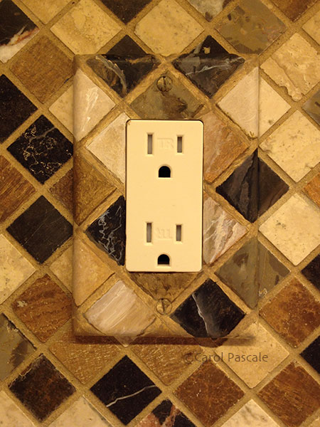 Painted outlet cover to match marble tile