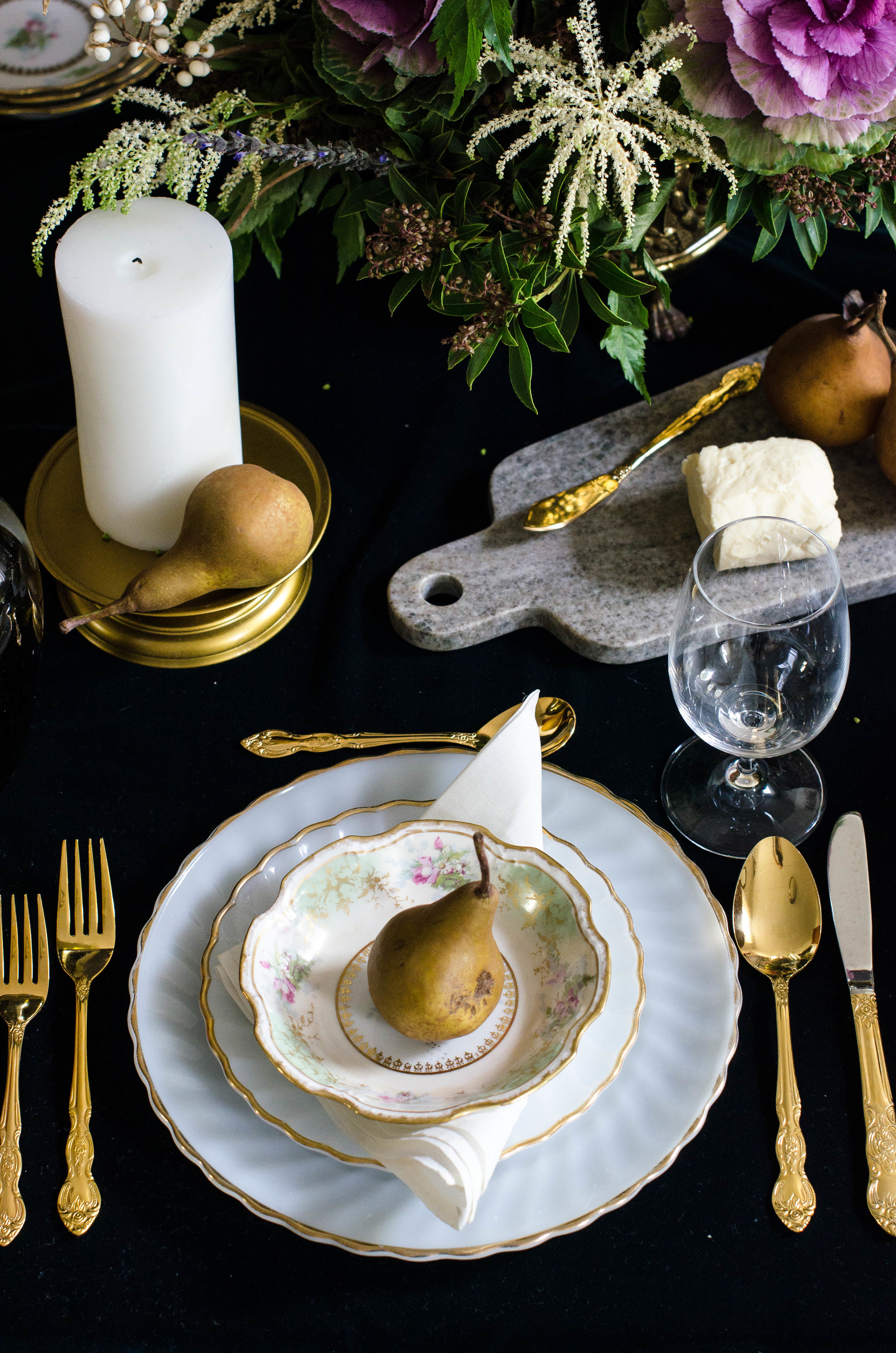 A Barlett pear and vintage French linen napkins create a simple, yet elegant table setting