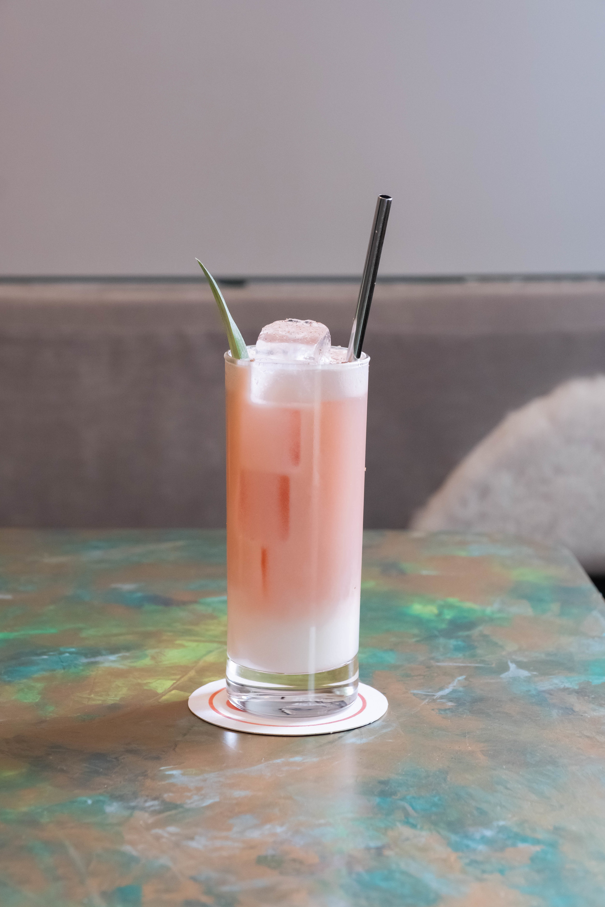 Pretty in pink, The Coconut, which is a sweet combination of pineapple, coconut milk, cream of coconut, San Pellegrino Aranciata Rosso and nutmeg.