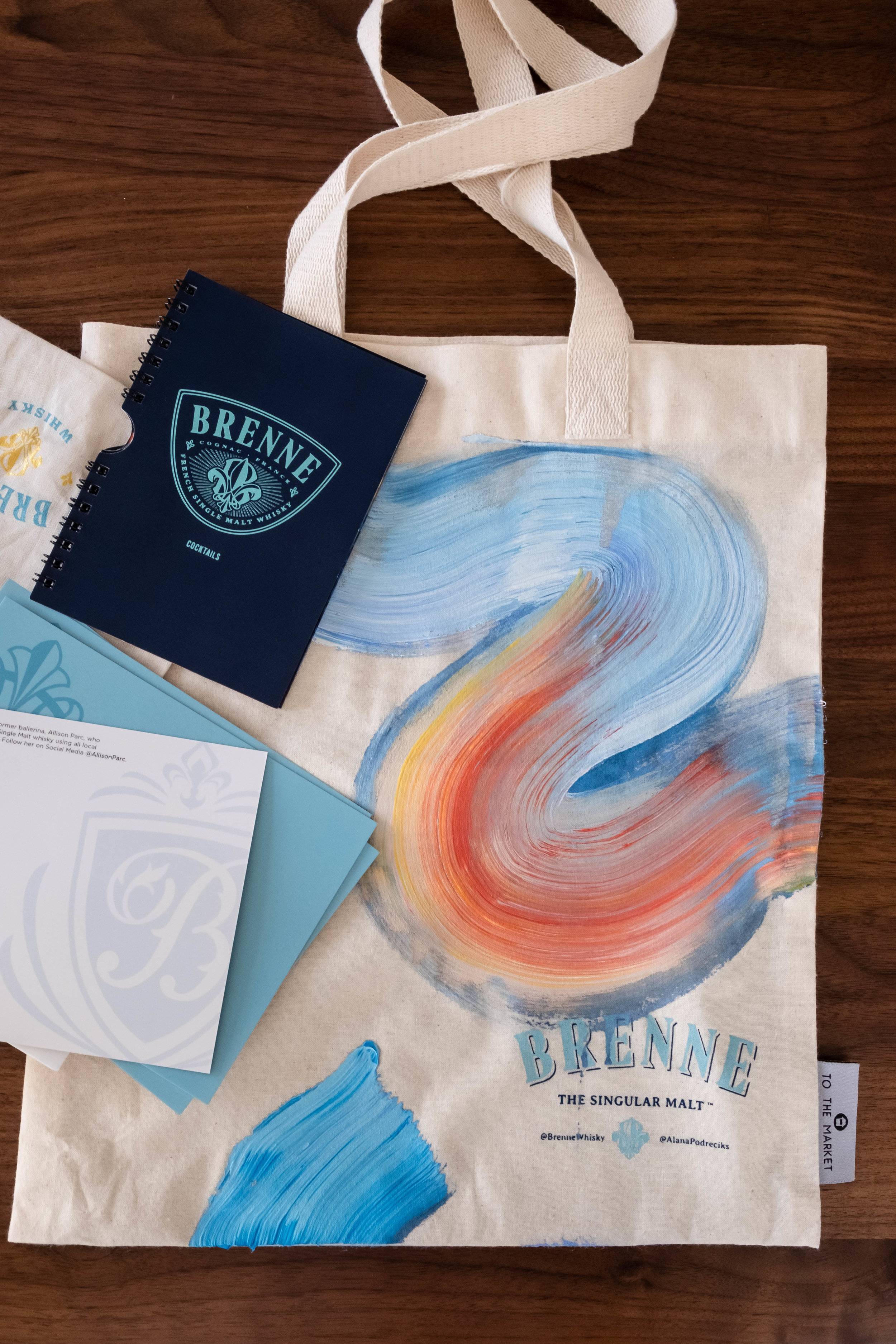 Brenne worked with artist  Alana Podreciks  to create colorful, one of kind tote bags.