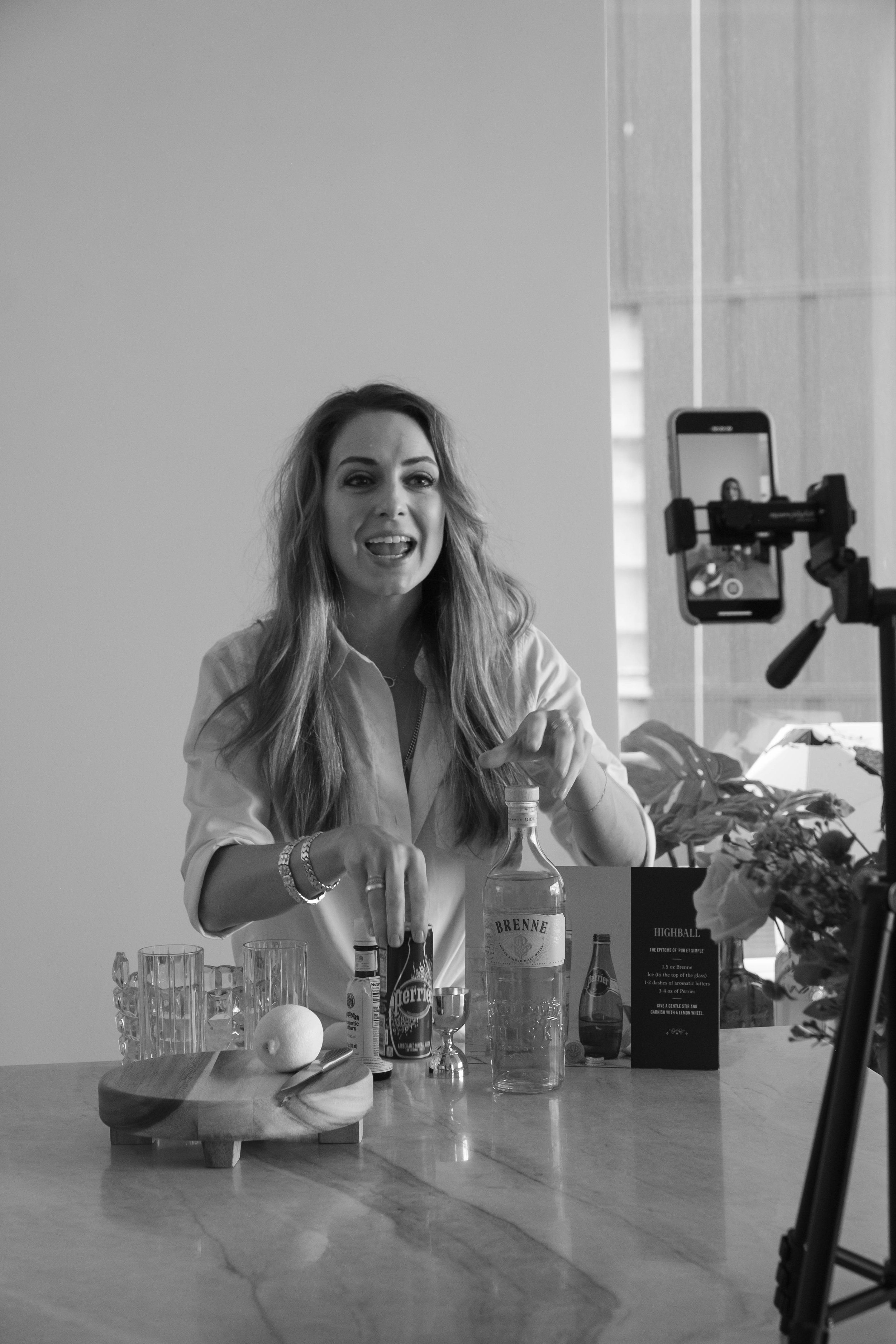 Creating videos both for social media and future trainings is key to her brand. Here she is mixing a highball that combines Perrier and bitters.