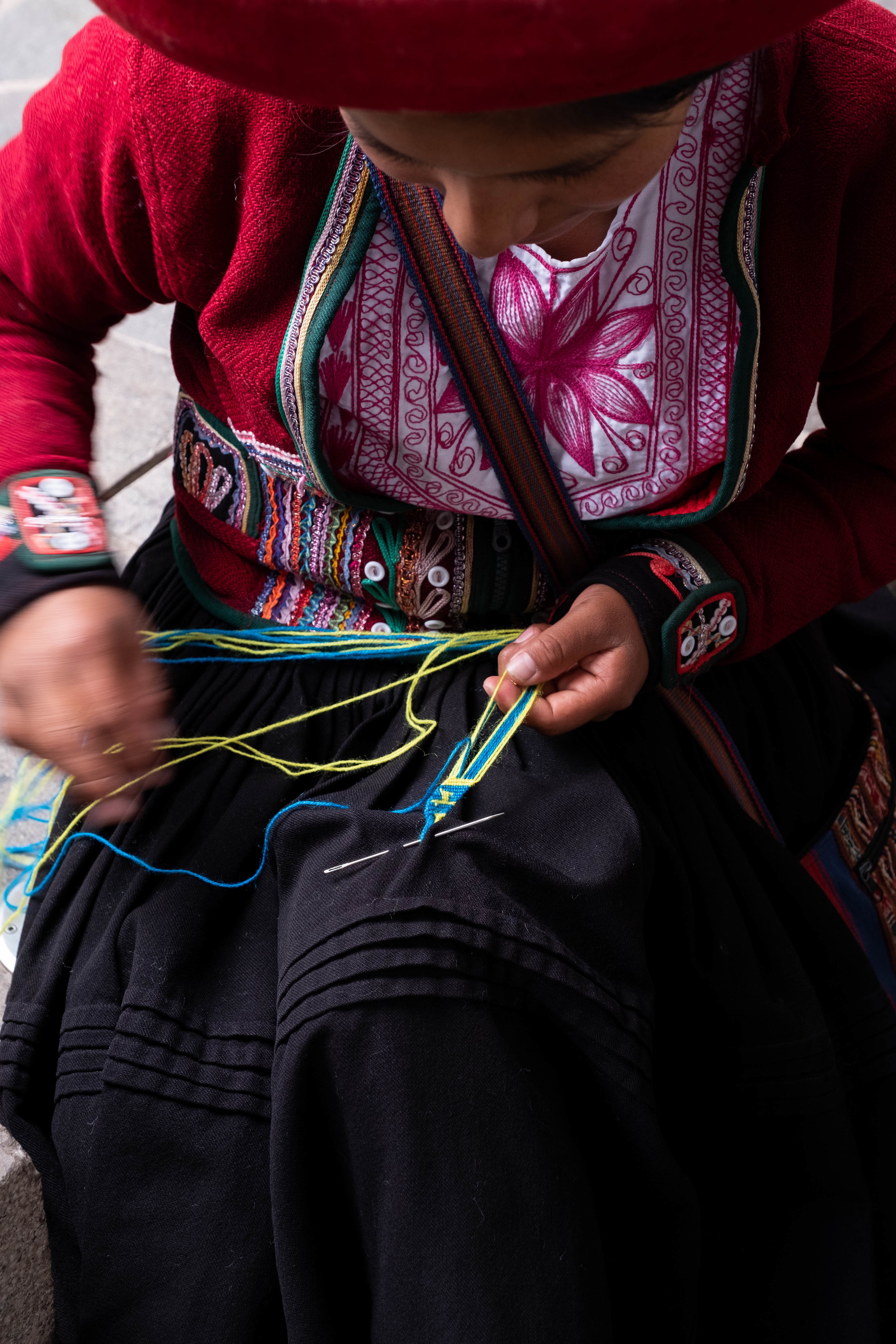 The art of weaving. Visitors can purchase locally woven scarves, blankets and small trinkets in the courtyard.