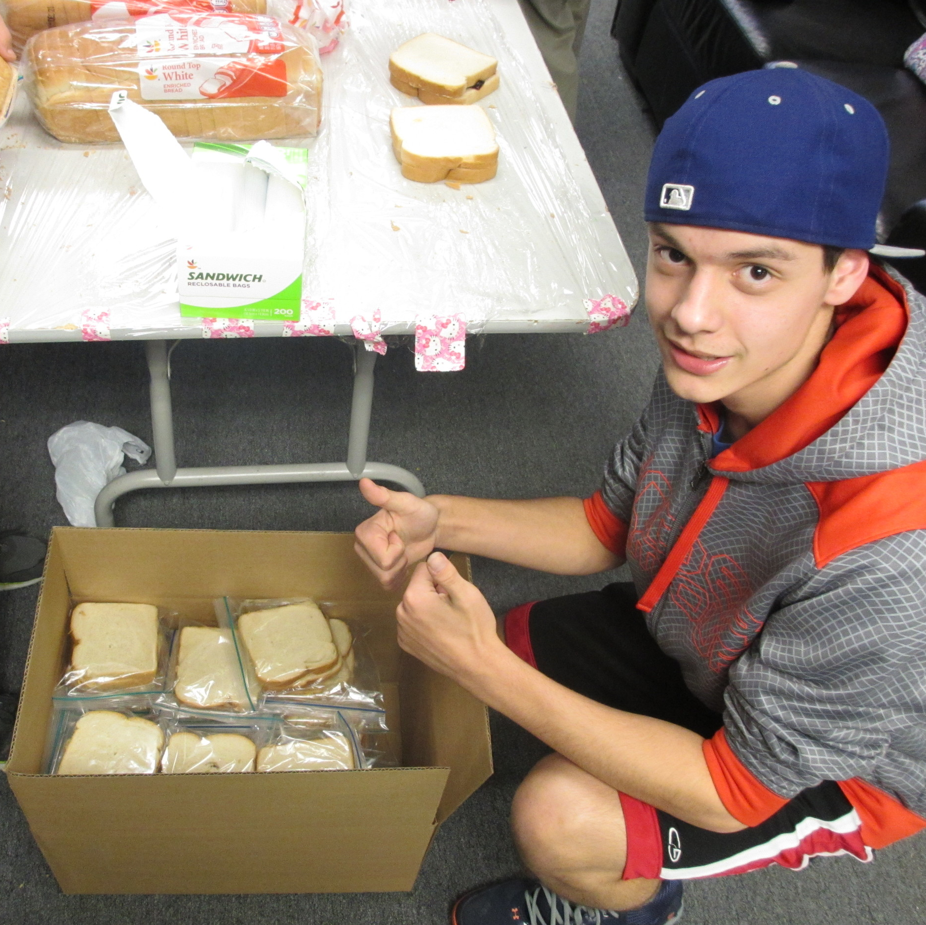 Josh packing up 150 PB&J sandwiches for delivery to a DC homeless shelter.