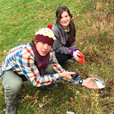 Paul & Jodie planting native plants at Rutherford Park in Fairfax.