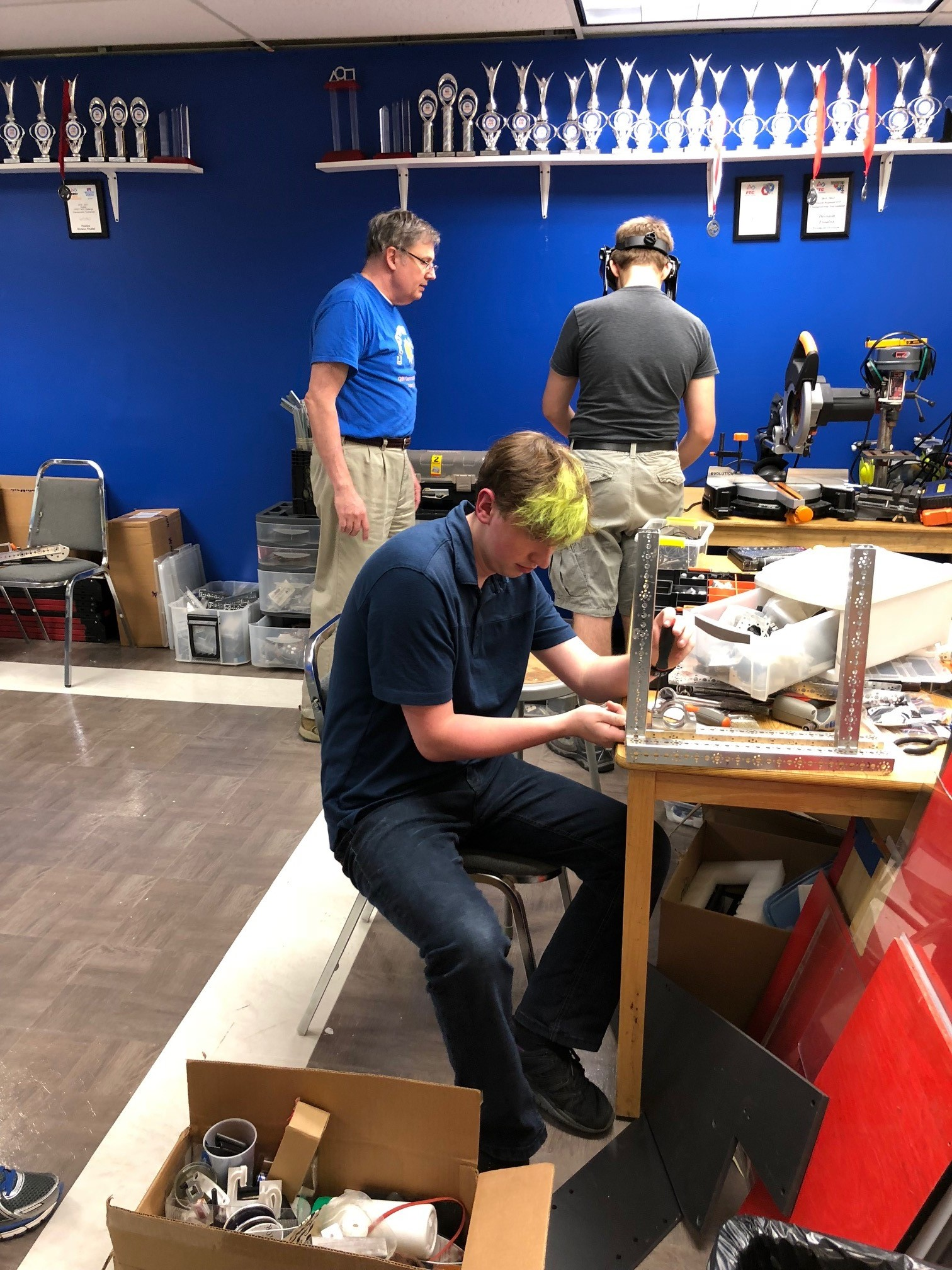 Michael E assembles while Mark uses the scroll saw.jpg
