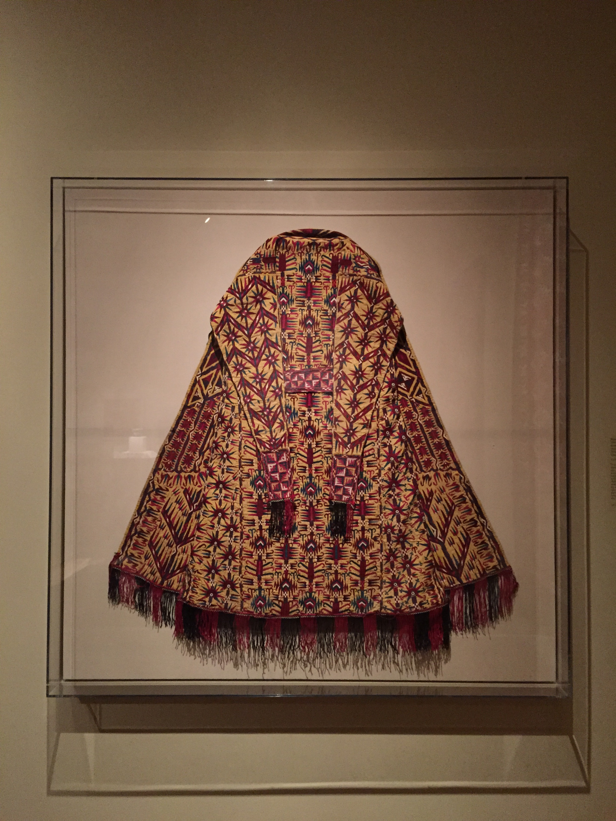 Woman's Mantle (Chyrpy),   late 1800s-1900s   Exterior: silk; plain weave; embroidery: chain stitch  Trim: silk; tablet-woven with fringe  Lining: cotton, plain weave, block printed  Central Asia, Turkmenistan, Tekke tribe