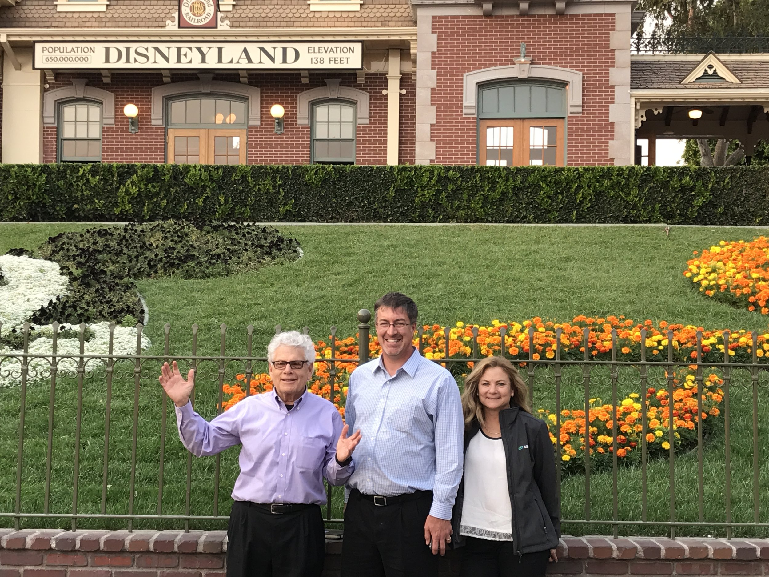 Savioke's Bob Bauer, Steve Cousins, and Lauren Schechtman take a break from Demo Day rehearsals to visit the Happiest Place on Earth.