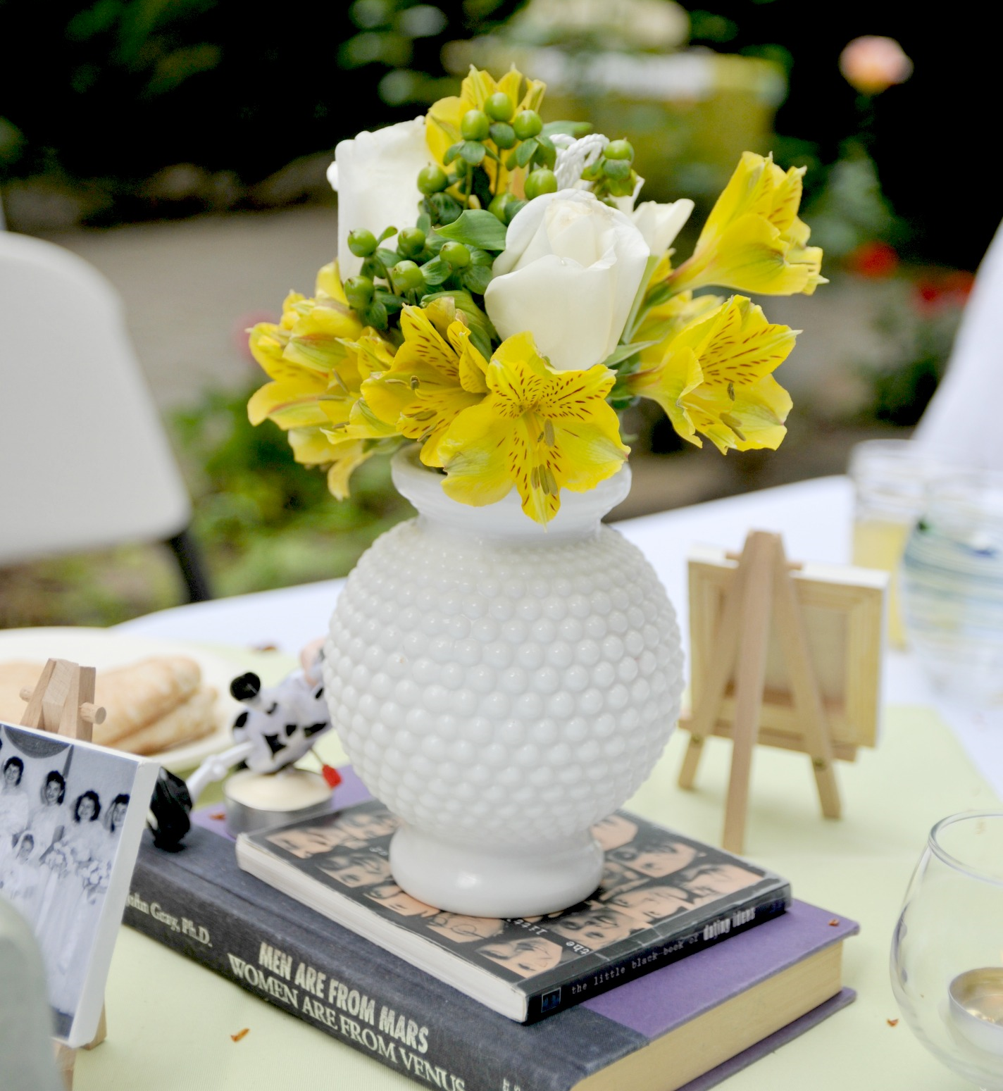 Centerpiece from the Sweetheart Table-notice the title of the books?   Picture by Natalie Arabadzhi Photography
