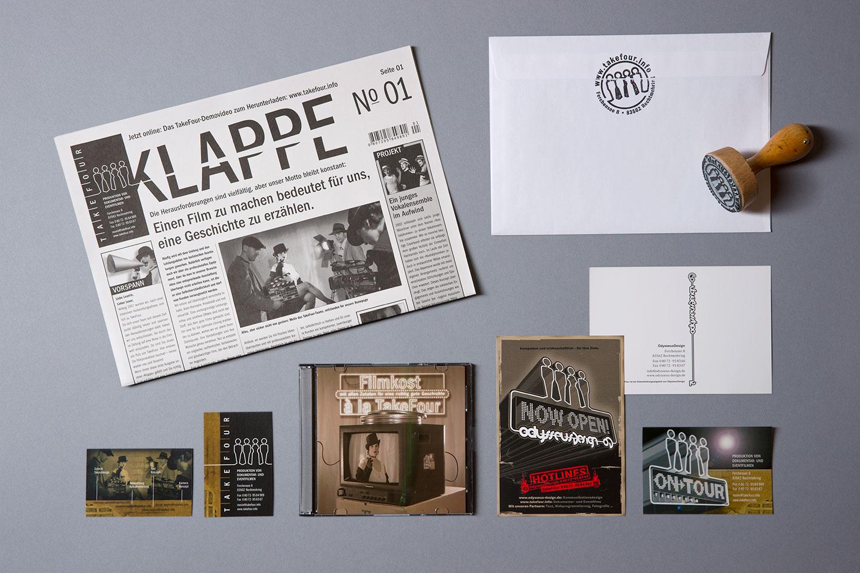 Imagezeitung, Visitenkarte, Demofilm, Postkarte, Aufkleber, Kuvert und Stempel