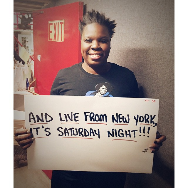 """Leslie Jones posing with the cue card from her first ever """"LIVE FROM NEW YORK, IT'S SATURDAY NIGHT!"""""""