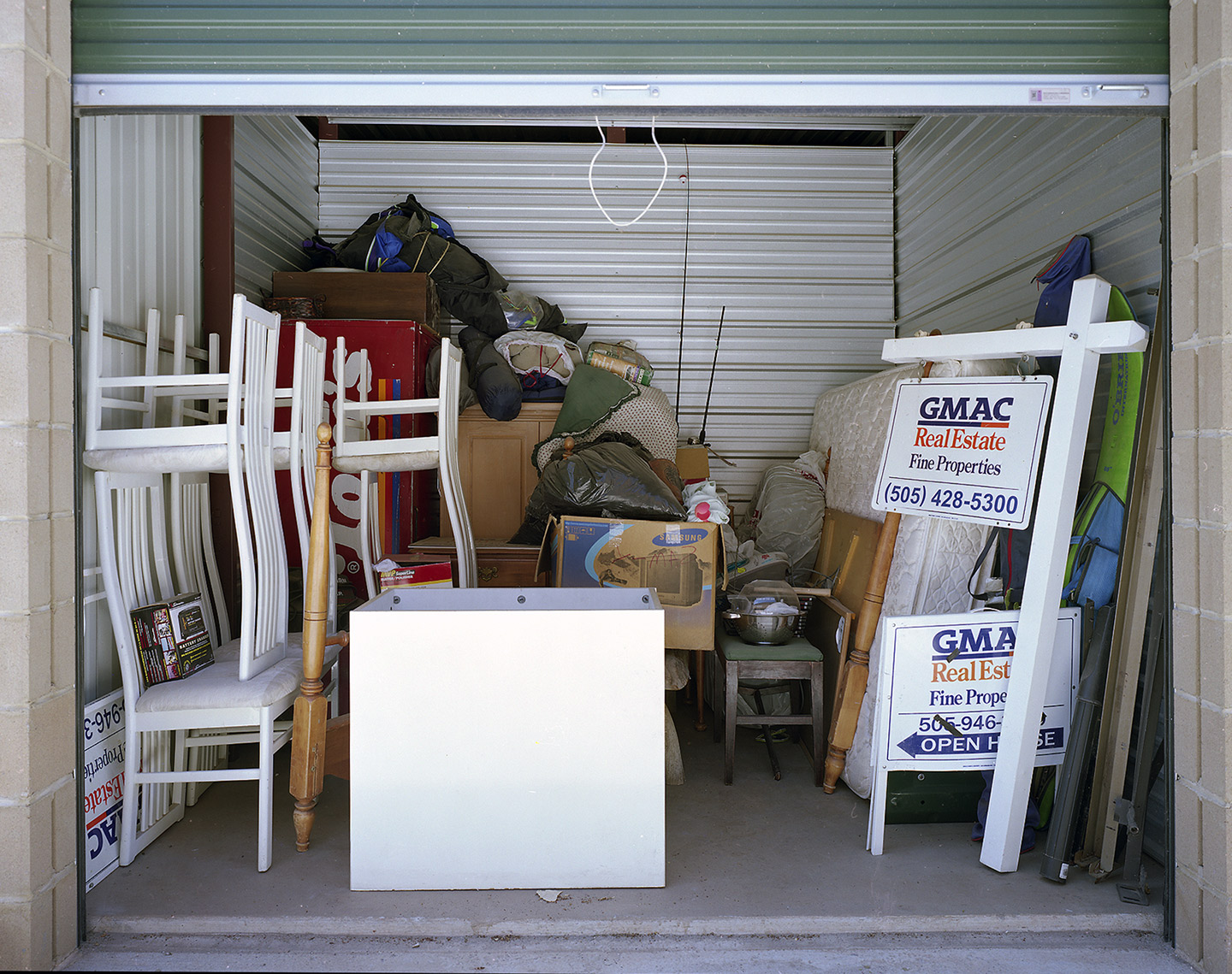 People use self-storage to store their stuff, often in response to disruptions in their domestic lives. But when unemployment, foreclosure, and other calamities force people out of their homes, storage units can be appropriated for new uses.