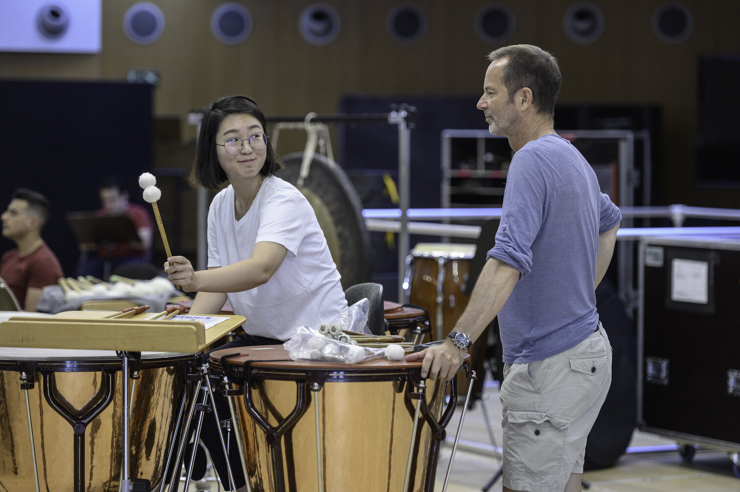 At El Seminario in Spain, Mahler Chamber Orchestra timpanist Martin Piechotta works with Dudamel Foundation Artist Eunji Park, August 2019. Photo by May Zircus.