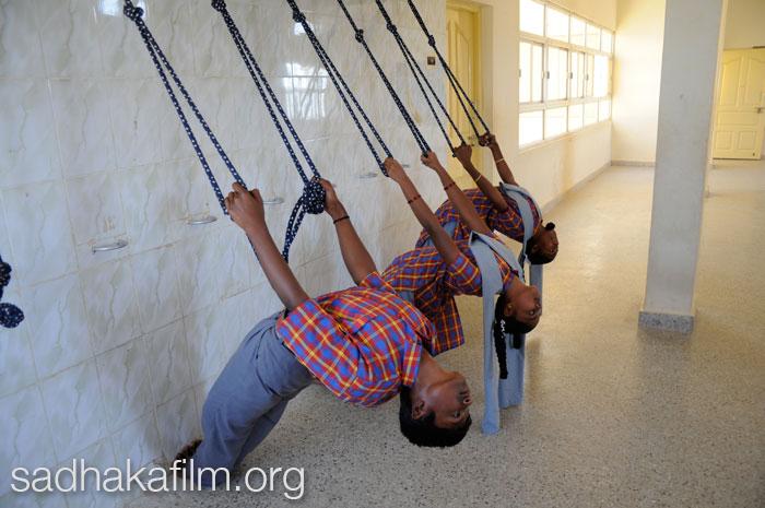 Students in Purvottanasana in the yoga room at the Ramamani Sundararaja Iyengar High School, Bellur, India.   Photo by Lindsey Clennell.