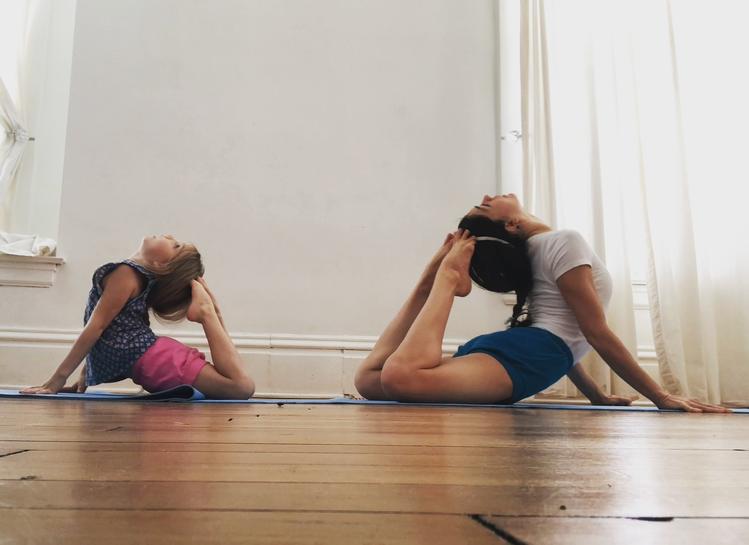 mother & daughter practicing Rajakapostasana. Who is teaching who?