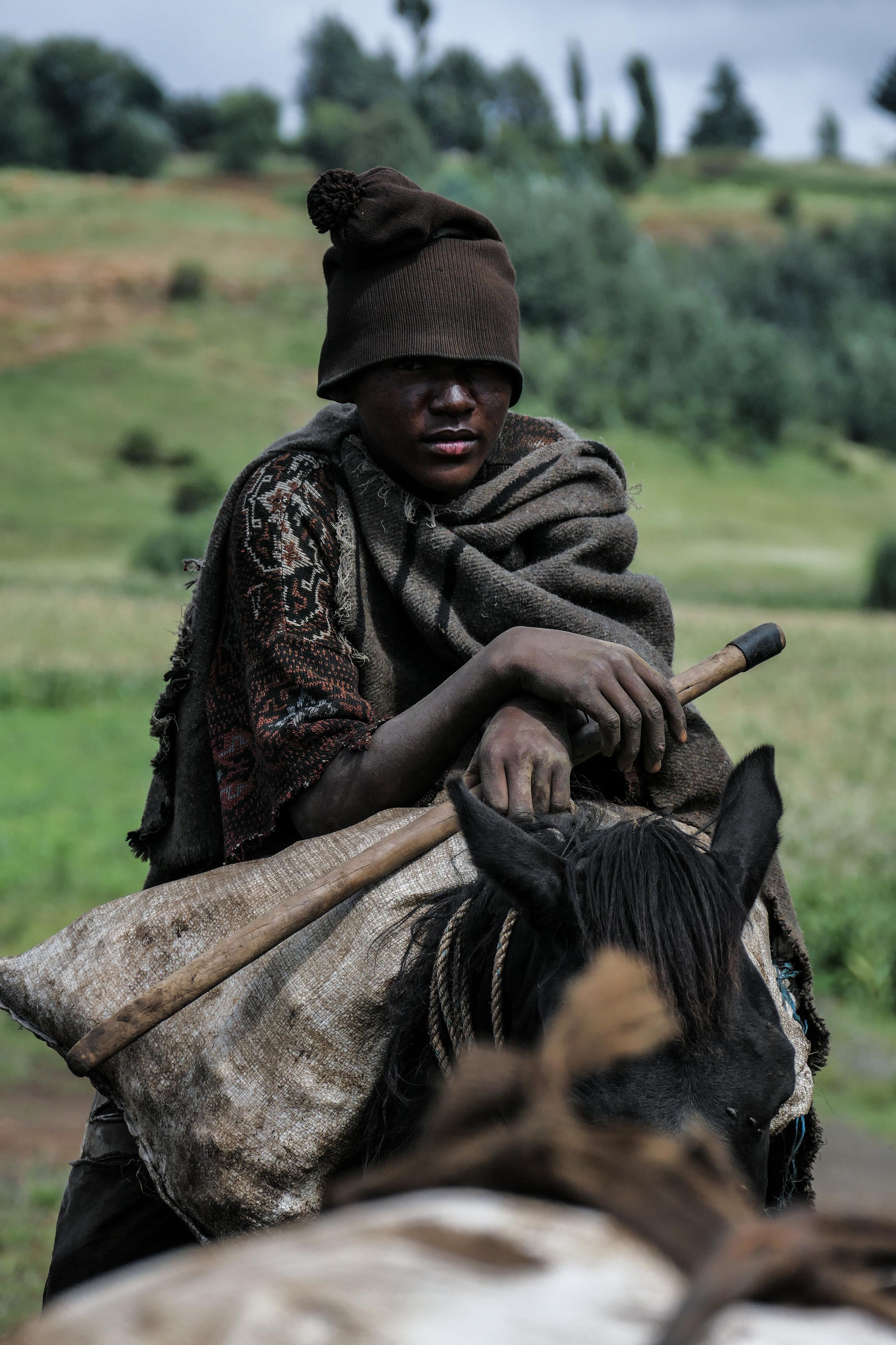 Basotho shepherd wearing traditional recycled wool Basotho blanket