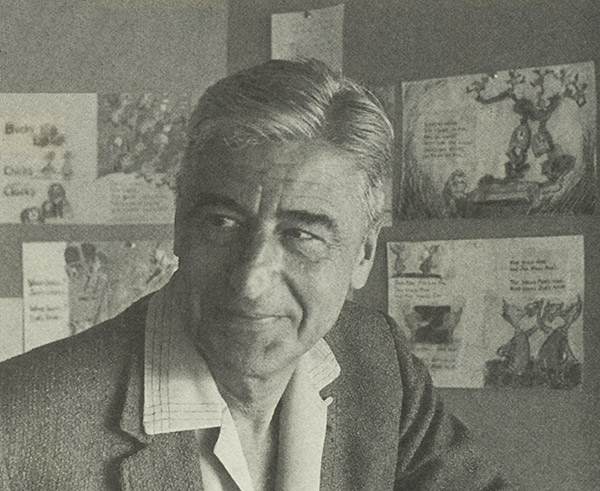Theodor Seuss Geisel in his story with storyboards for   Fox in Socks   behind him.