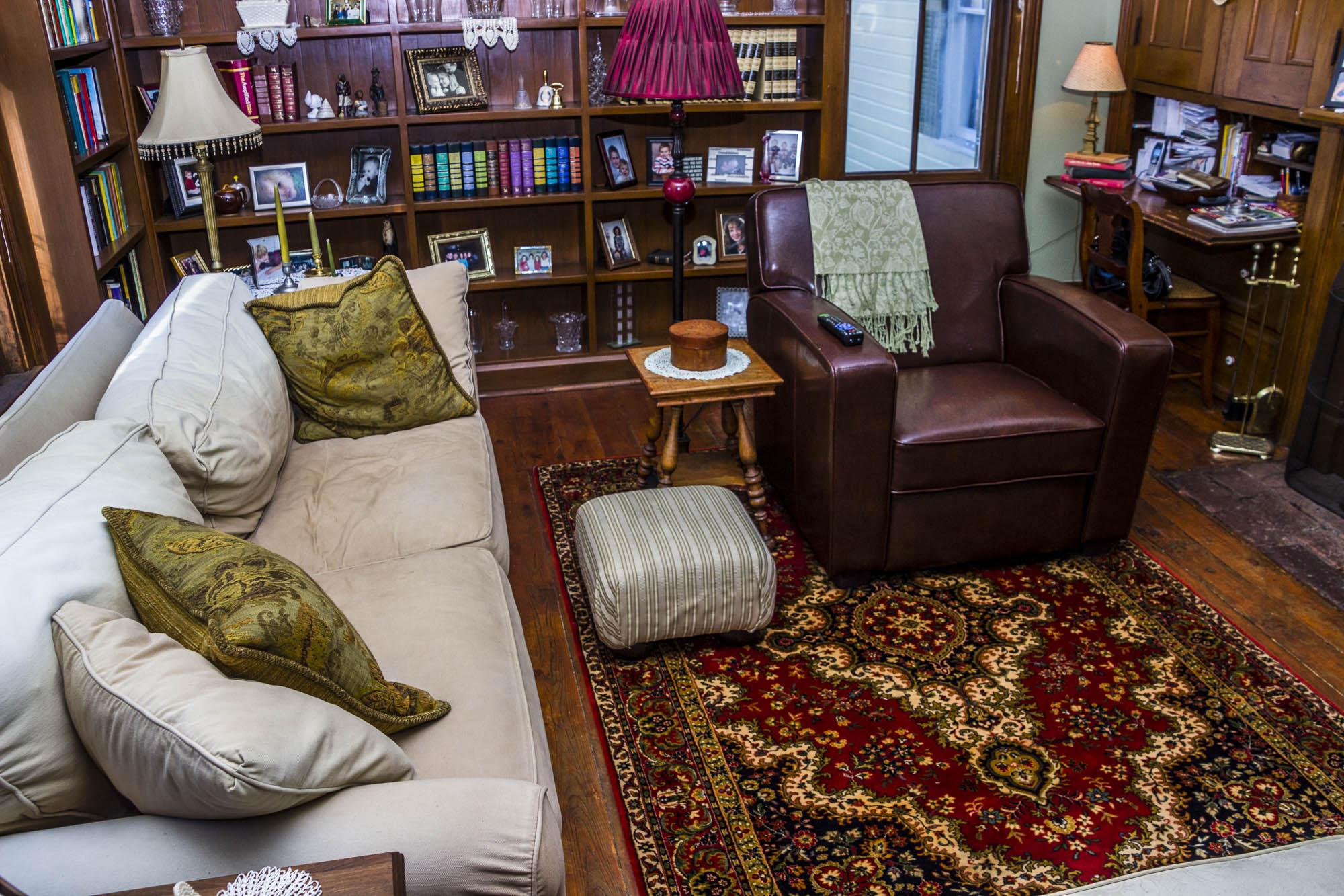 Downstairs sitting room. TV, bookshelves, lots of comfort.
