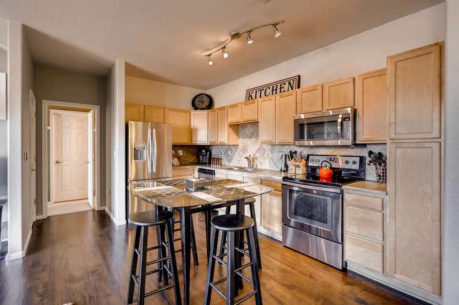7140 S Wenatchee Way Unit H-small-004-9-Kitchen-666x444-72dpi.jpg