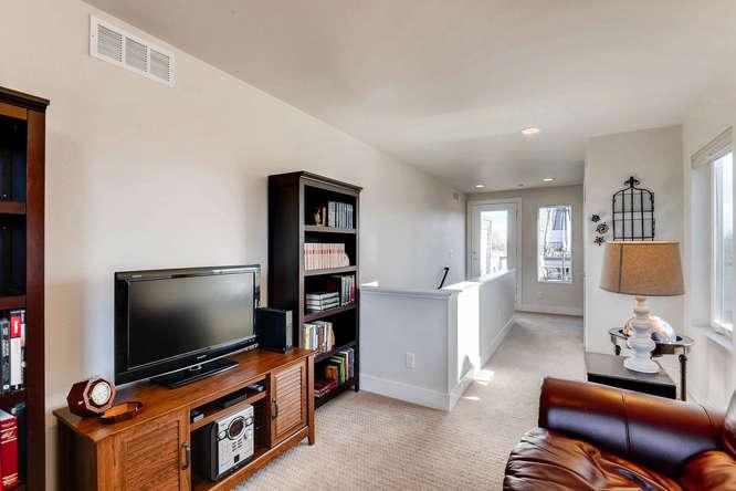 5012 E Thrill Pl Denver CO-small-022-20-3rd Floor Family Room-666x445-72dpi.jpg