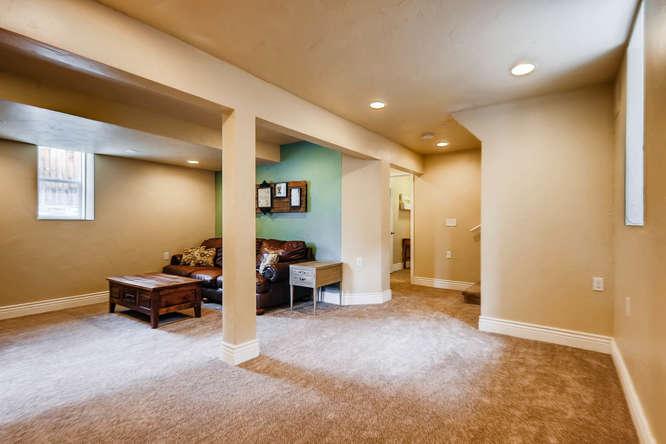 3534 E Bruce Randolph Ave-small-021-19-Lower Level Family Room-666x444-72dpi.jpg