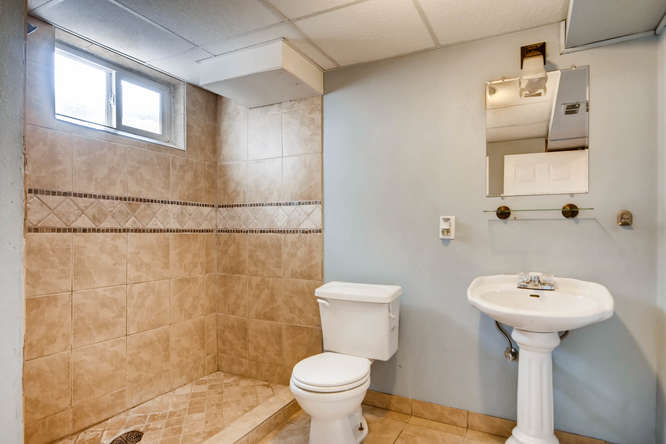 7061 Clay St Westminster CO-small-024-19-Lower Level Bathroom-666x444-72dpi.jpg