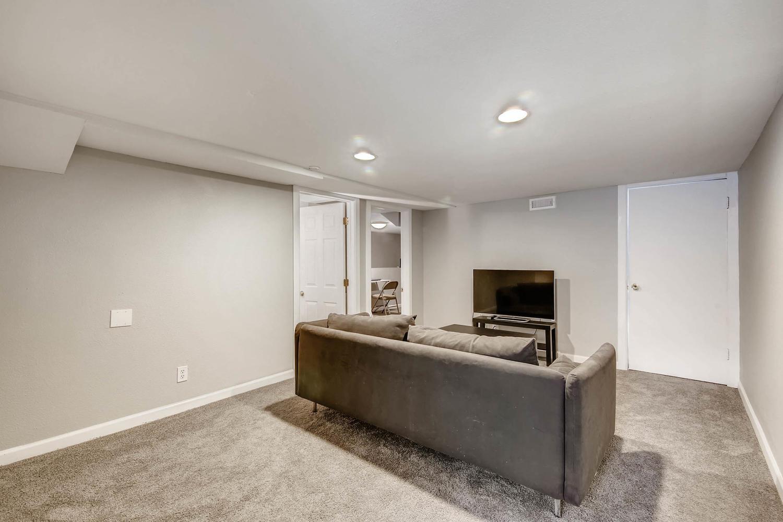 3576 Bruce Randolph Ave Denver-large-016-26-Lower Level Family Room-1500x1000-72dpi.jpg