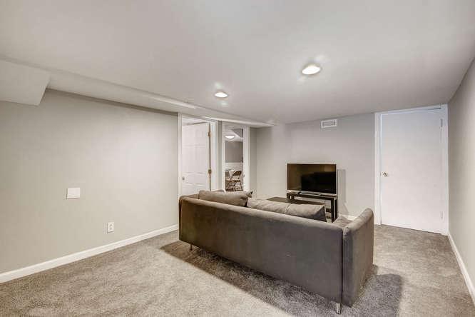 3576 Bruce Randolph Ave Denver-small-016-26-Lower Level Family Room-666x444-72dpi.jpg