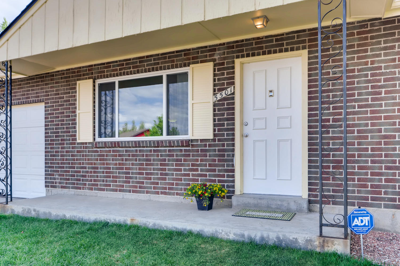 5501 Altura St Denver CO 80239-large-002-28-Exterior Front Entry-1500x998-72dpi.jpg
