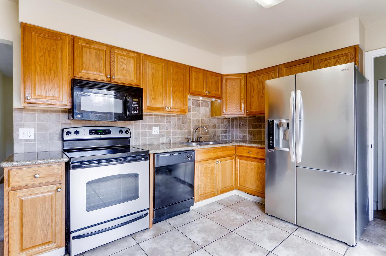 5501 Altura St Denver CO 80239-large-009-11-Kitchen-1500x999-72dpi.jpg