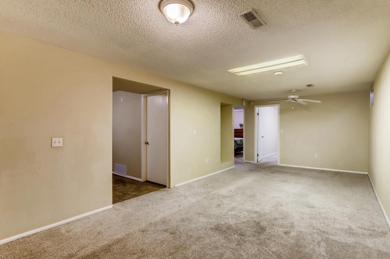 5501 Altura St Denver CO 80239-large-018-16-Lower Level Family Room-1500x998-72dpi.jpg