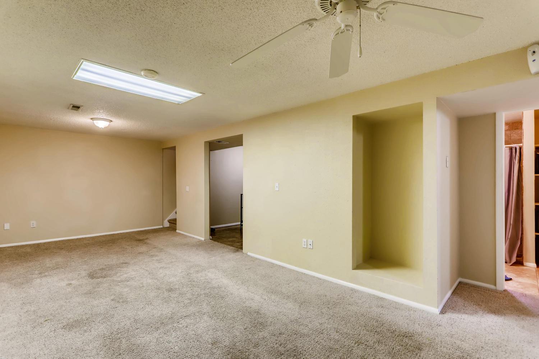 5501 Altura St Denver CO 80239-large-019-14-Lower Level Family Room-1500x998-72dpi.jpg