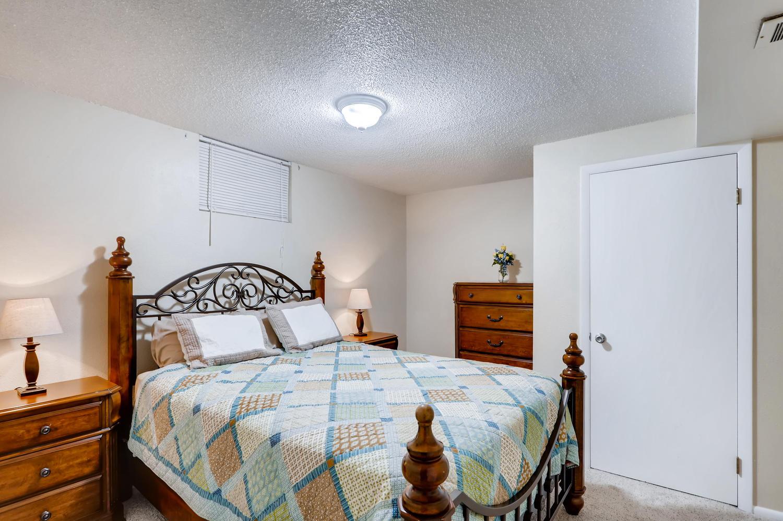 5501 Altura St Denver CO 80239-large-020-19-Lower Level Bedroom-1500x998-72dpi.jpg