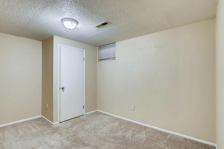 5501 Altura St Denver CO 80239-large-022-18-Lower Level Bedroom-1500x998-72dpi.jpg