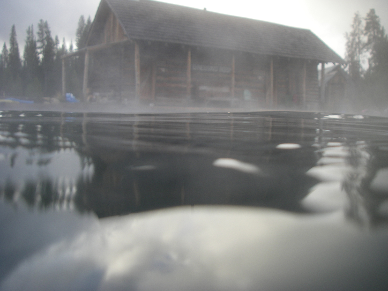 A swimmer's view of the changing rooms at the hot springs.  (Image by Emily Benson)