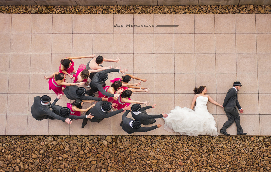 Creative shot of Bride and Groom running away