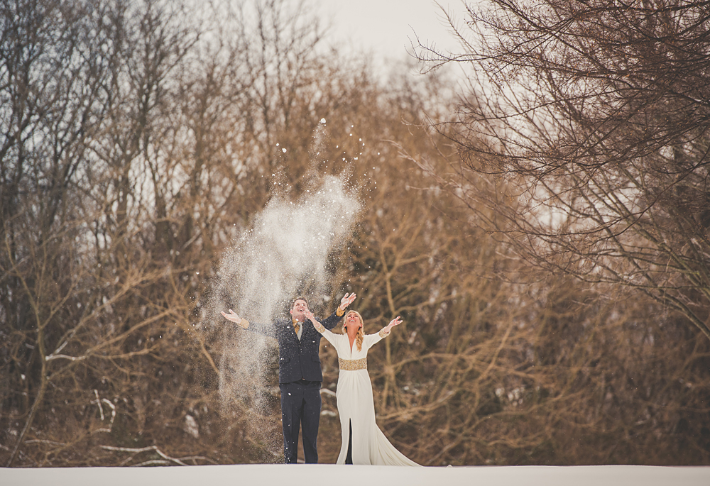 throwing snow in the air, bride and groom