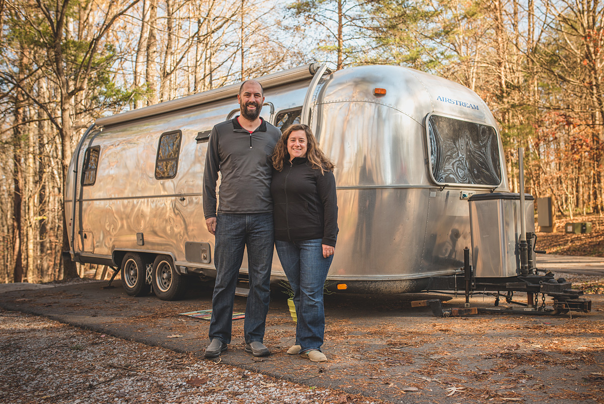 The Watsons in front of their 1999 Airstream!