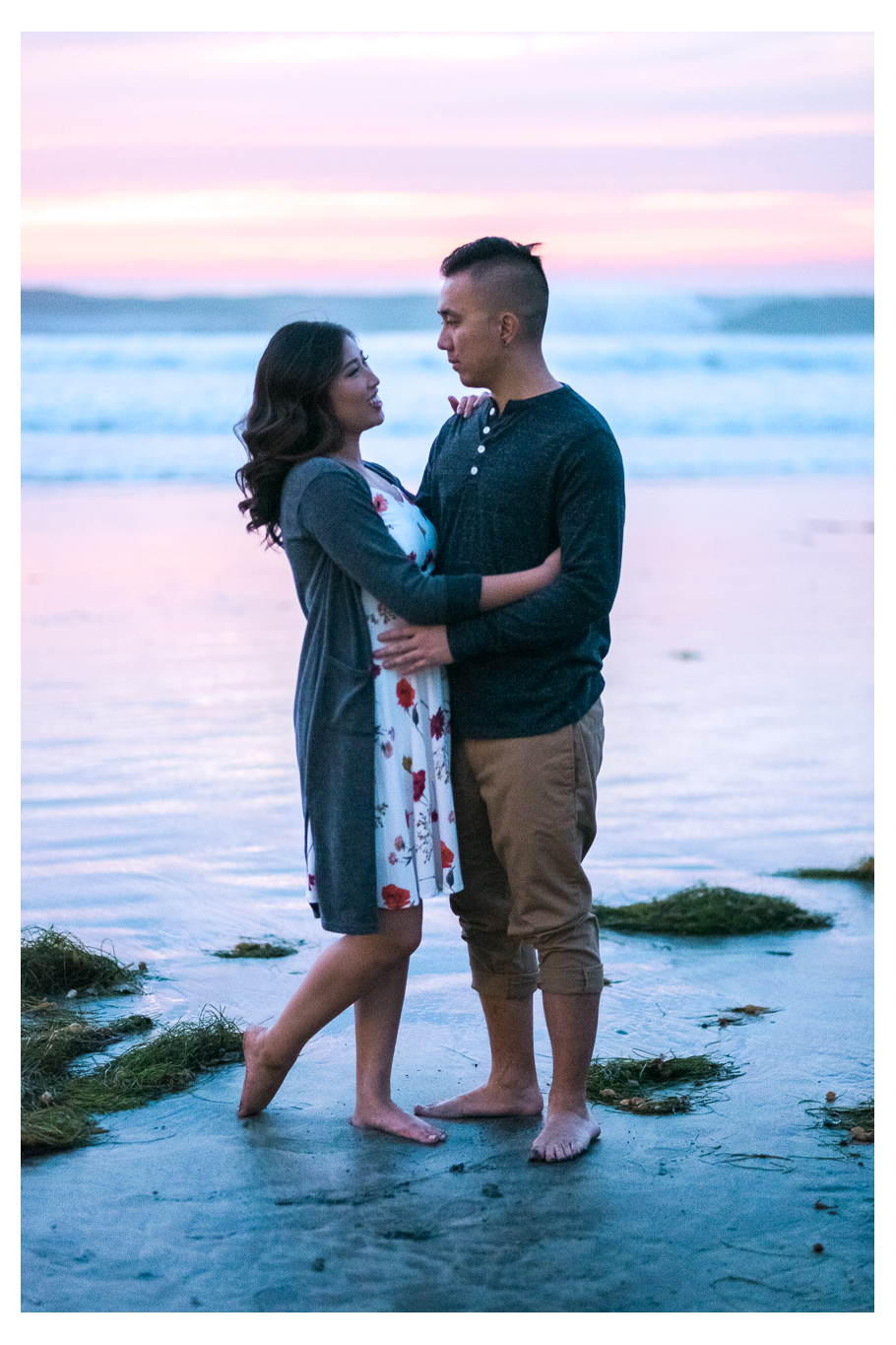 during sunset engagement session at La Jolla shores by the pier