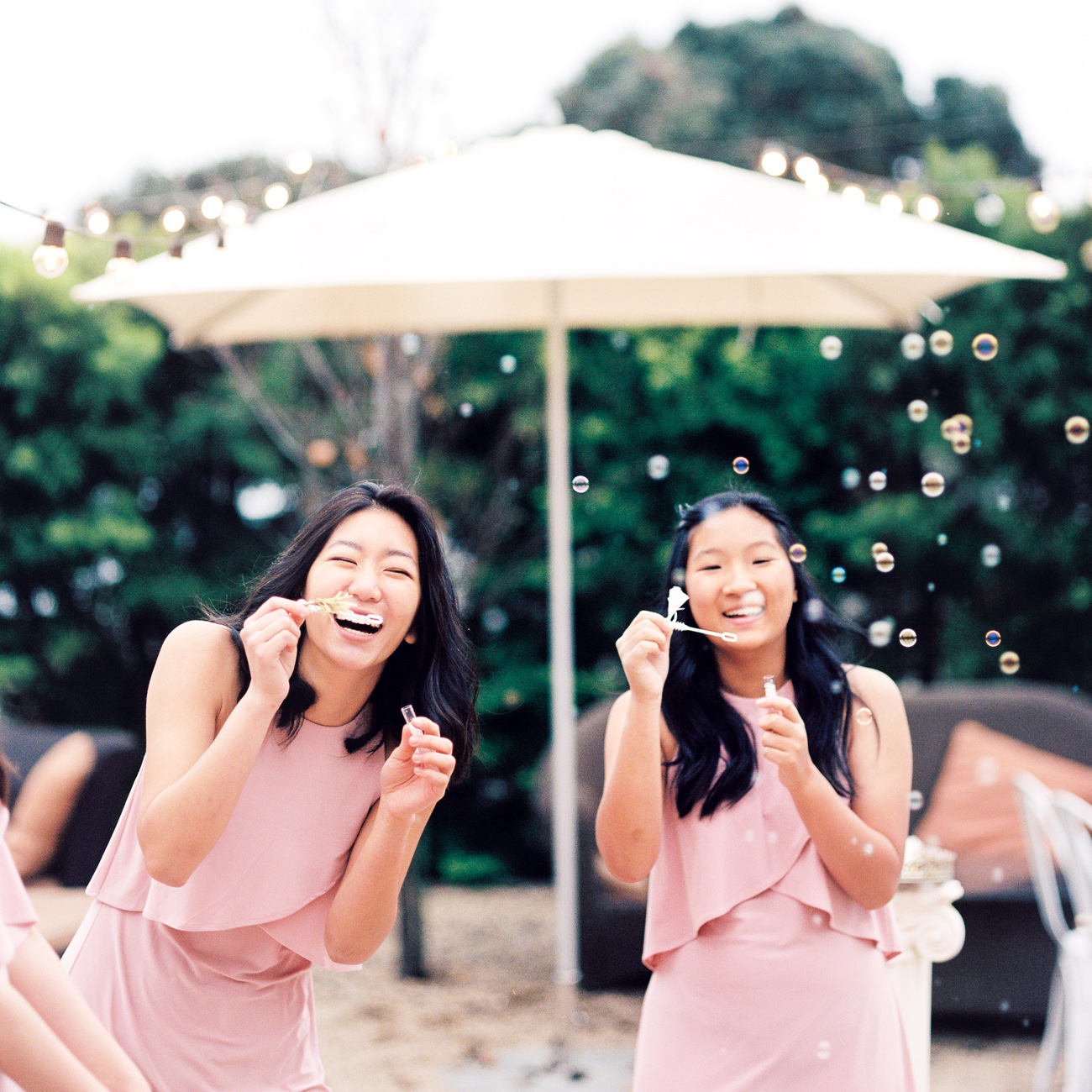 fine art wedding photography california guests blowing bubbles