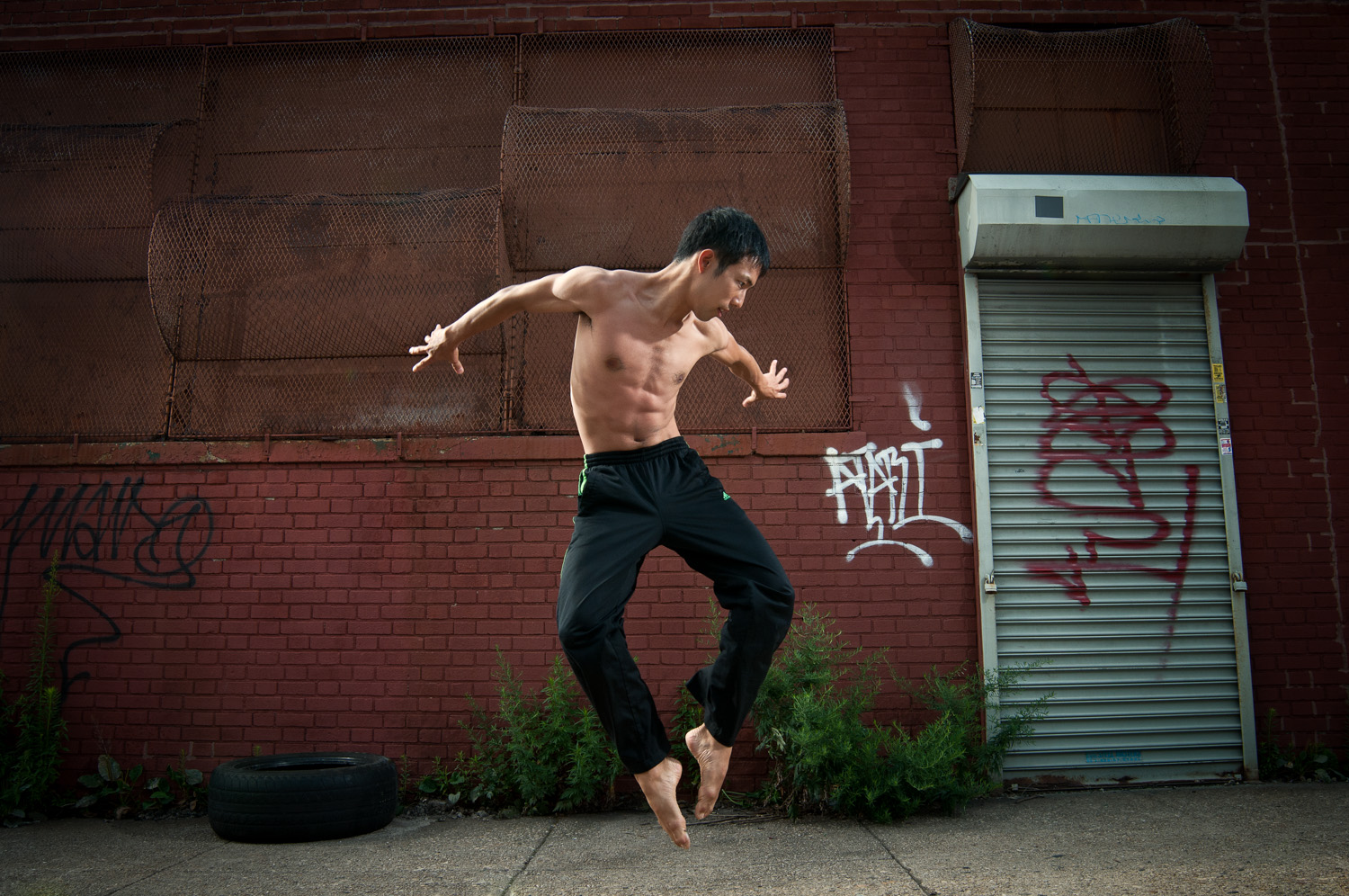 Portrait photograph of male dancer jumping
