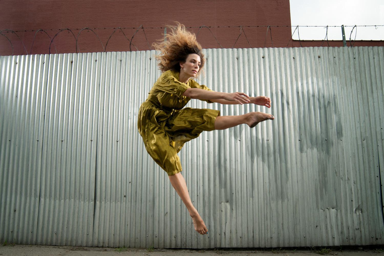 Portrait photograph of female dancer jumping