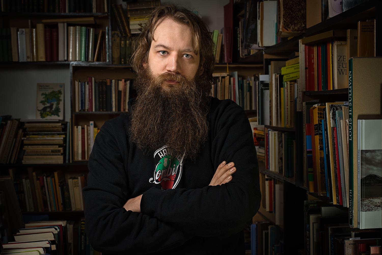 Portrait of caucasian man in bookstore