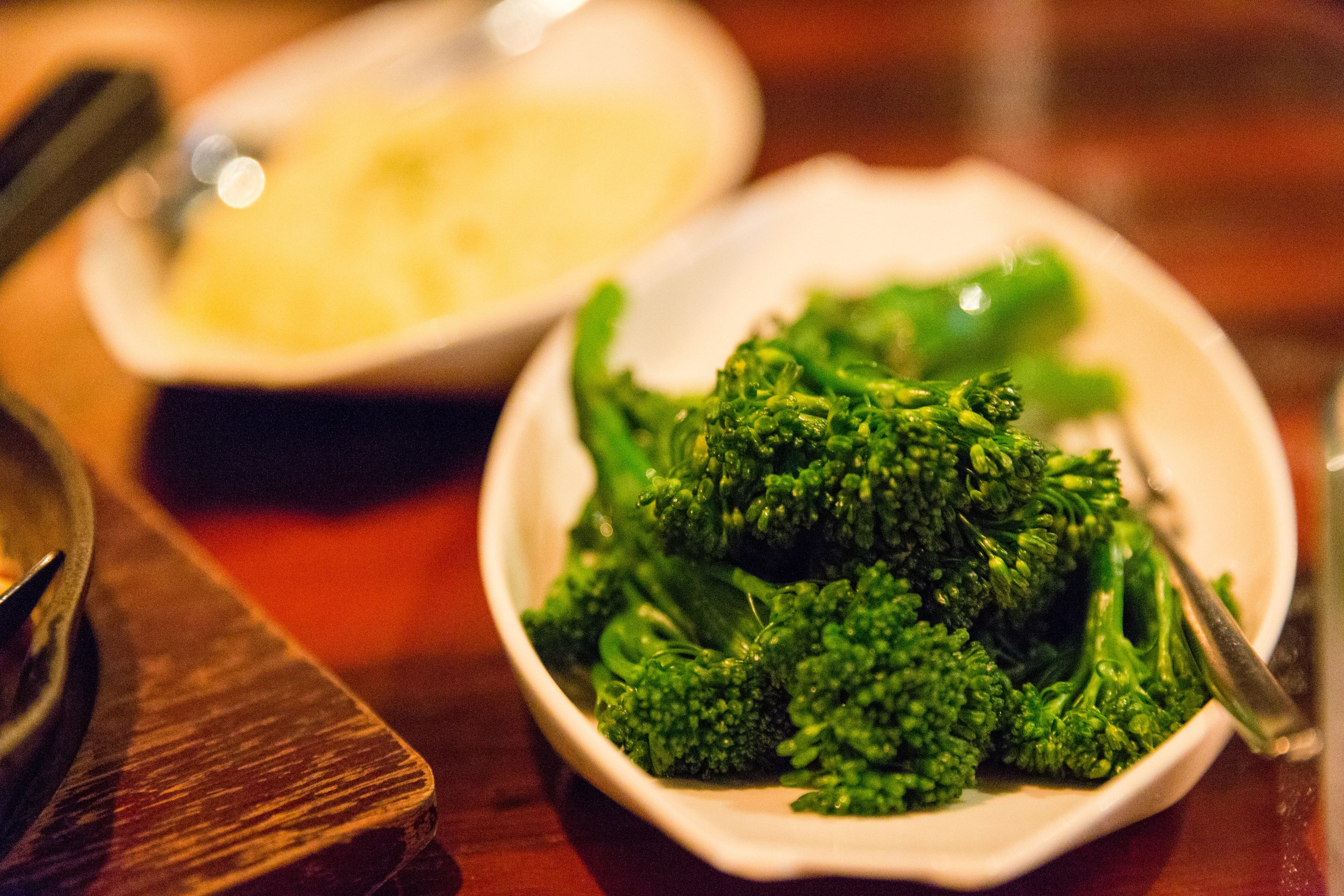 Broccolini and the Truffle Mash in the background