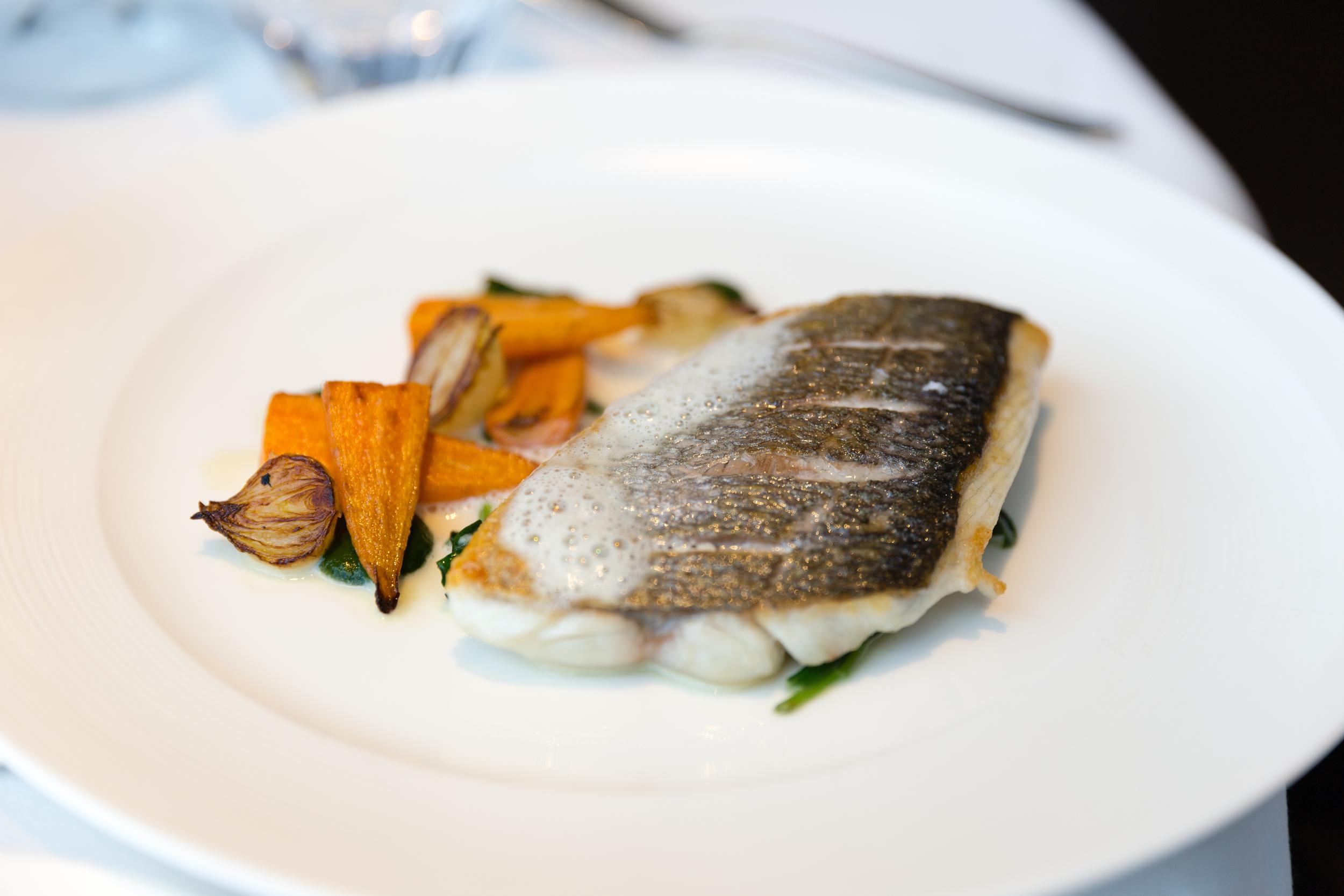 Sea Bass - Root vegetable ragout, edamame beans, yuzu butter emulsion