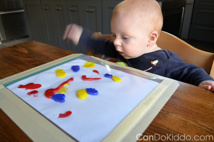 baby finger painting sensory play
