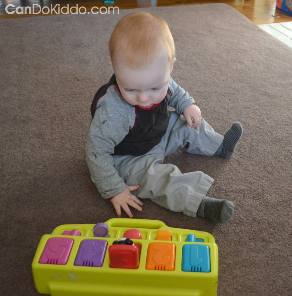 Play to promote hands and knees crawling position. CanDo Kiddo