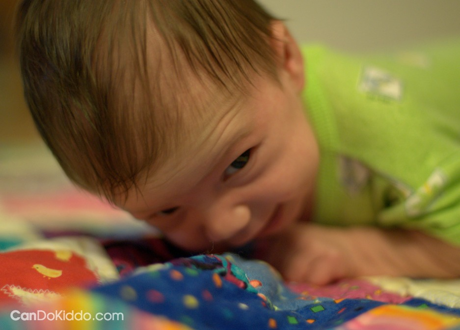 The value of tummy time when baby can hardly lift her head. CanDo Kiddo