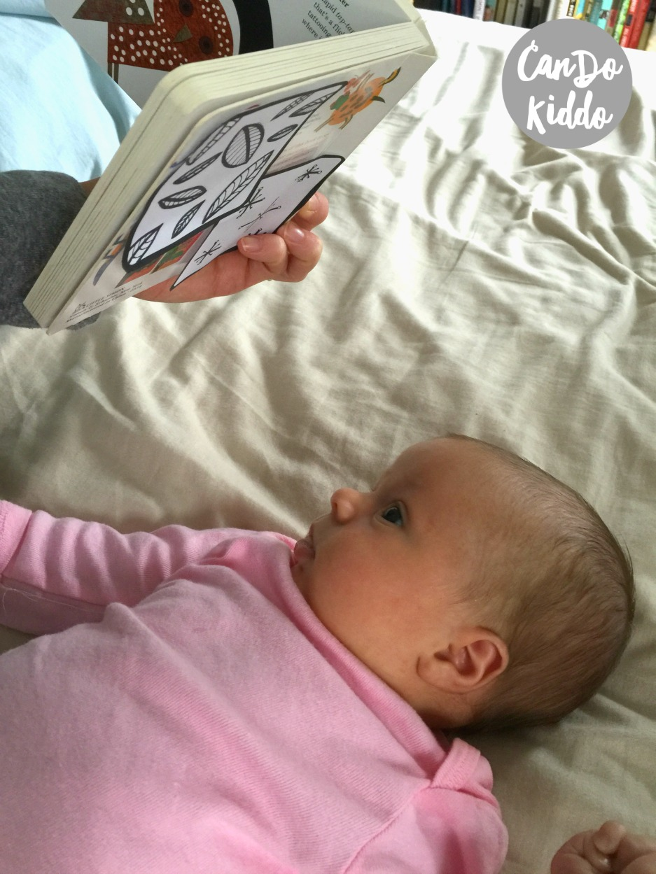 Mom hack - keep baby entertained while you read to toddler. www.candokiddo.com